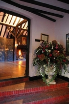 Entrance with roaring fire